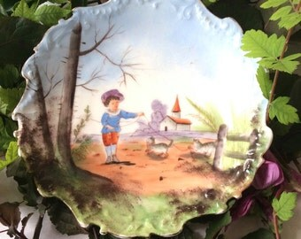 Art-Deco antique plate. French china Limoges . Child and cats.