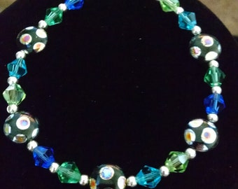 Blue, green, and black beaded bracelet