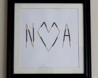 Custom Couple's Initials in burnt matches.