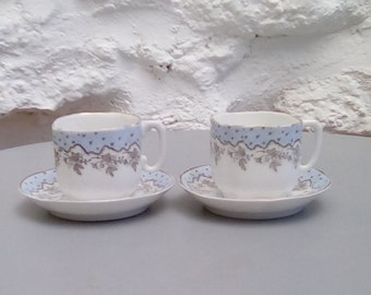French porcelain coffee cups. Lovely pair of demitasse cups and saucers