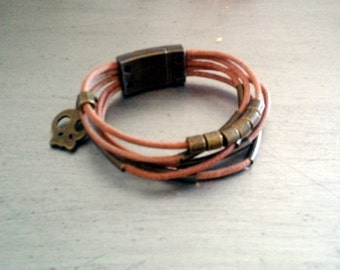 Boys child leather with copper beads and deadhead charms cuff  with magnetic closure