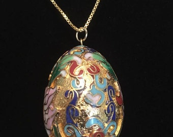 Gold Faberge style egg necklace