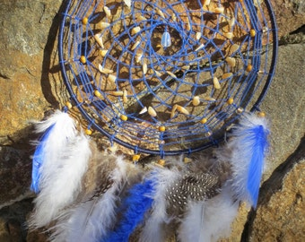 Large dark blue, brown, and white dream catcher