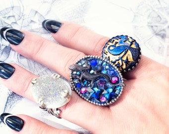 somber reptiles oval lizard ring with blue and purple crystal rhinestones
