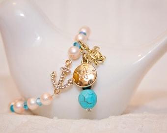 Anchor charm bracelet, turtle charm jewelry, sand dollar charm, sea ocean jewelry, elegant pearl stretch bracelet, beach charm bracelet