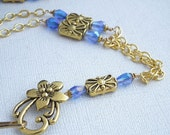 Gold Plated Chain ID Badge Lanyard with Gold Rectangular Beads and Blue Crystals.