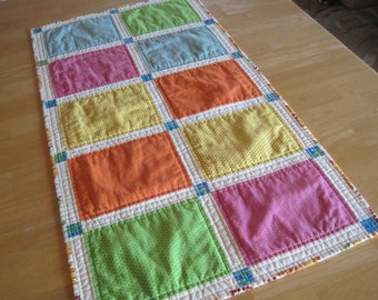 Quilted table runner in bright colors