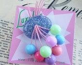 La-la-la-Lilac! Sparkling lilac flecked 40s 50s confetti lucite style novelty pastel cherry brooch by Luxulite