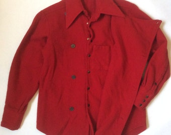 Double breasted 1970's outdoorsman's shirt in scarlet red wool, with hidden pockets and dark brassy buttons and snaps, men's medium