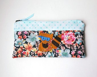 "Zipper Pouch, 4.75x9.25"" in blue, pink, brown, gray, cream, red and yellow floral Fabric with Handmade Felt Racoon, Raccoon Pencil Case"