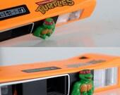 Retro TMNT 110 Camera  Teenage Mutant Ninja Turtles film Analog Photography photo imprint Orange Orange Kids Toy Vintage 80s TheHeartTheHome