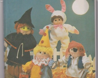 """Simplicity 7116 """"Costumes for 18"""" Soft Sculptured Dolls Such as Precious Pals and Cabbage Patch Kids"""" Size for 18"""" doll"""