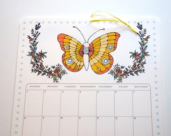 2017 Wall Calendar, Size 11x17 Inches featuring 12 different butterfly illustrations in green, pink, yellow, fuchsia, purple and orange
