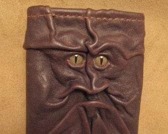 Grichels leather tri-fold wallet - dark chocolate brown with green speckled slit pupil reptile eyes