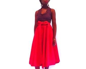 Mid length high waist skirt with bow.