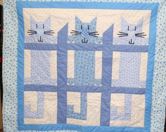 Baby blue Cats on the Fence quilt
