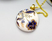 Porcelain necklace, white with gold and blue flowers