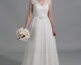 Ivory lace wedding dress, sleevelss V-back alencon lace with tulle skirt.
