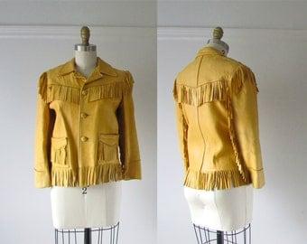 vintage 1950s buckskin jacket / fringe leather jacket
