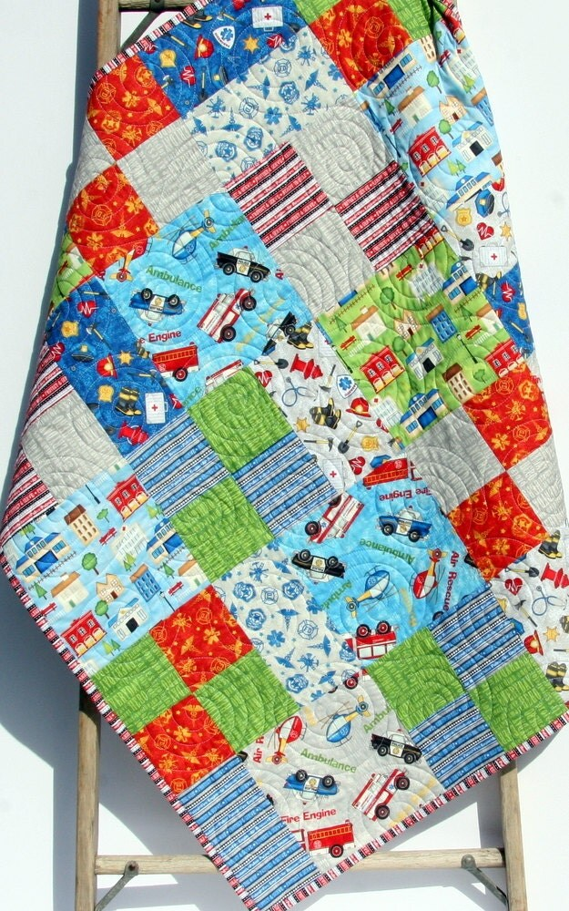 Baby boy quilt primary red blue bedding car fire truck rescue for Little blue truck fabric