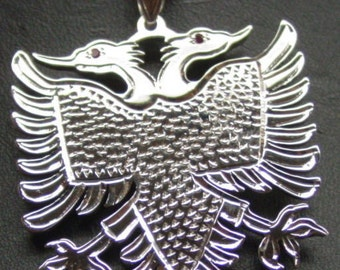 albanian eagle, with a chain 1.5'' size .2 mm thick . solid sterling silver. Rhodium  plated. eag12
