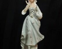 Vintage White Ceramic Colonial Woman with Hand Painted Accents Holding Basket Figurine ~ Mid Century Home Decor