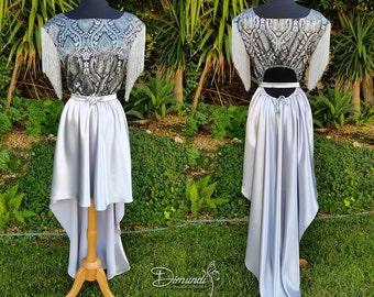 Vestido de brocado de plata siglo XIX