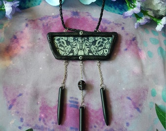 Black tribal shamanic pendant with howlite spikes and a scull