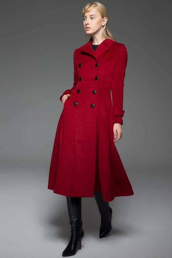 A women's Valentino Roma red virgin wool single button-front jacket. The jacket is impeccably tailored with a wide notched collar, three-quarter length full sleeves, finished seams, and vertical pockets at the waist with buttoned half-belt band at the back.