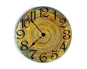 Green and yellow wall clock with rust swirl and speckles in the middle. Circle design.