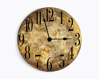 Golden brown marble looking wall clock. Circle design.