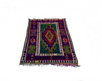Vintage Moroccan rug woven by hand from scraps of fabric / boucherouite / boucherouette