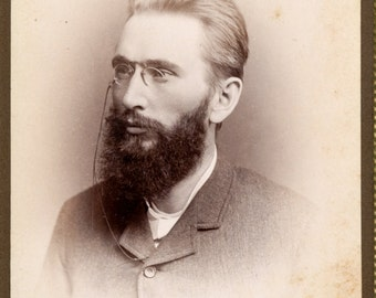 Cabinet Card of bearded man wearing glasses