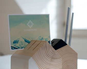 Two wooden houses as pencil and cardholder.