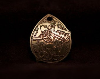 Celtic Art Pendant, The Beard Pullers. Etched in Brass. Adapted from The Book of Kells.