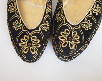 Black Flats with brocade pattern all over Size 8