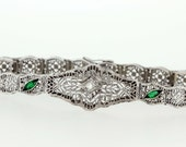 14K White gold emerald and diamond filigree bracelet
