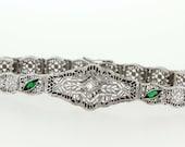 14K White gold emerald and diamond filigree bracelet