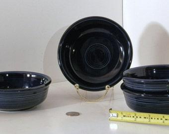 Four Dark Blue Fiesta Ware bowls
