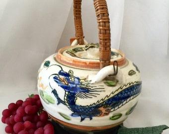 Vintage dragon teapot porcelain ceramic three toed dragon  bamboo handle made in Japan
