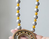 Brooch Necklace, antique yellow and silver beads