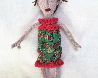 Hand Knitted Doll Wearing a Pretty Green and Red Dress