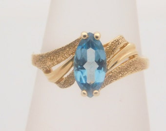 Ladies Marquise Cut Blue Topaz 14K Yellow Gold Ring