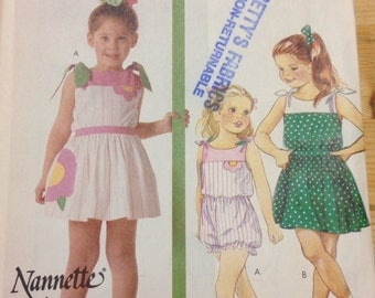 McCalls 2541 - 1980s Little Girl's Romper with Contrast Yoke and Skirt with Flower Design Options - Size 6