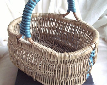 1950's CHILD'S delightful, UNUSUAL, original, vintage wicker BASKET with blue early plastic trim in excellent cond. for its age. One owner.