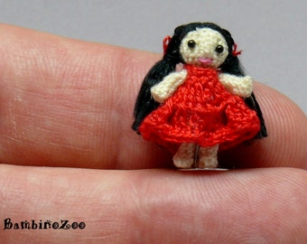 Miniature amigurumi girl doll with red dress. Comes with FREE display box.