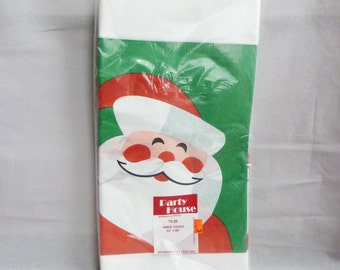 """1983 Christmas Tablecloth - Santa Claus Paper Table Cover - Vintage 1980s - 54"""" x 96"""""""