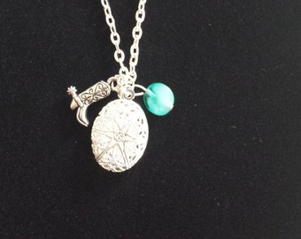 Essential oil Defuser Charm Necklace w/ additional aromatherapy defuser felt pads. Cowboy boot and Glass Turquoise colored bead,