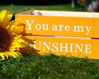Wooden crate with 'You are my SUNSHINE' painted message
