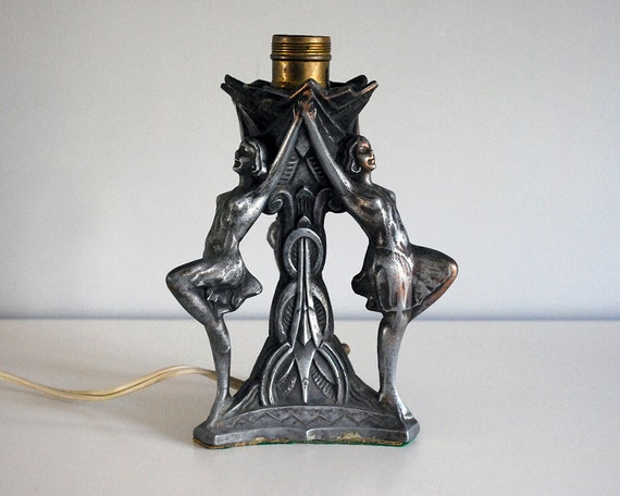 spelter girls Vintage art nouveau calling card receiver bowl girl on poppies spelter metal gvc shows wear 95 length 6 tall.